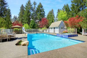 Picture of a swimming pool in the back yard. The concrete was poured around the swimming poo for the deck in Dayton, OH